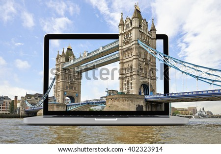 The Tower Bridge in London getting out the laptop, Tourism computing concept - stock photo