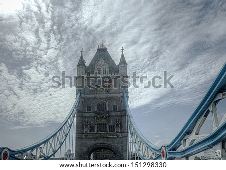 The Tower Bridge in London, UK, under a cloudy sky - stock photo