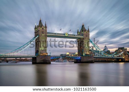 The Tower Bridge over the Thames River in London just after sunset