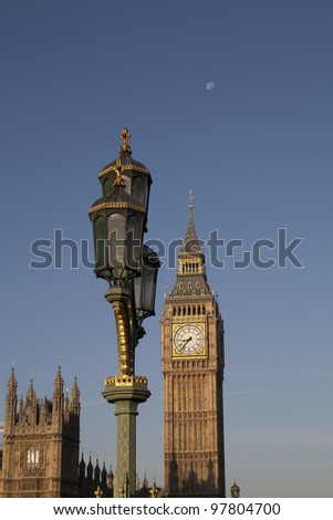 The tower of Big Ben, a Lamp and the Moon. - stock photo