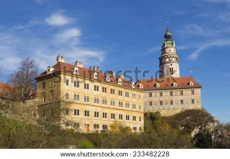 The tower of Cesky Krumlov over the beautiful blue sky - stock photo