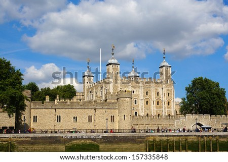 "The Tower of London, seen from the River Thames, with a view of the water-gate called ""Traitors' Gate""."