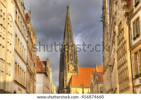 The tower of Saint Lamberti Church in the Prinzipalmarkt street with a Christmas tree in Munster, Germany