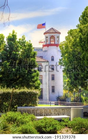 The tower of the historic Naval Medical Center and the sign in the Balboa park gardens in San Diego, southern California, United States of America. A park filled with outdoor recreational activities. - stock photo