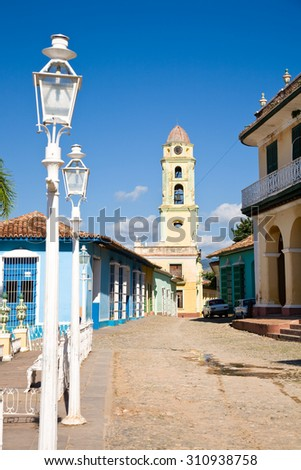 The tower of the San Francisco Convent seen from the Plaza Mayor, the center of the colonial city of Trinidad, Cuba - stock photo