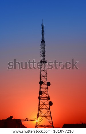 The towering radio towers under the sunset