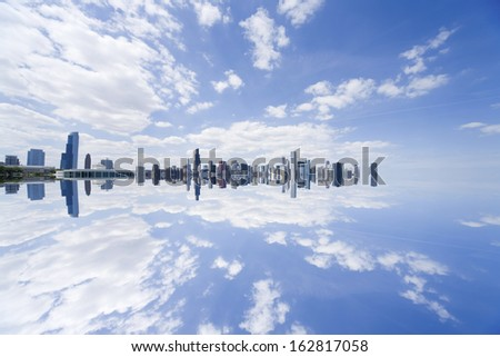 The town in Chicago reflected in the water surface
