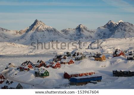 The town of Tasiilaq (former: Ammassaliq)  in East Greenland on the Tasillaq-Fjord. Shot in October 2008. - stock photo