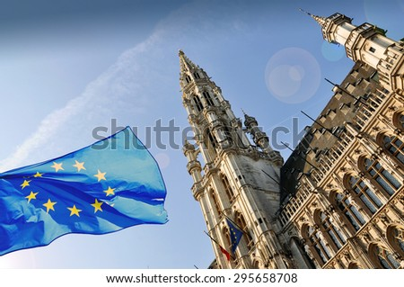 The townhall of Brussels and a flag of European Union  - stock photo
