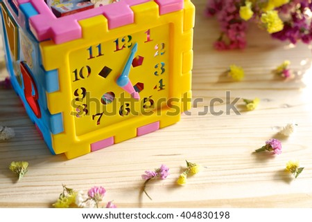 The toy clock. Selective focus. - stock photo