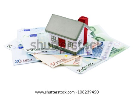 The toy house for euro banknotes isolated - stock photo