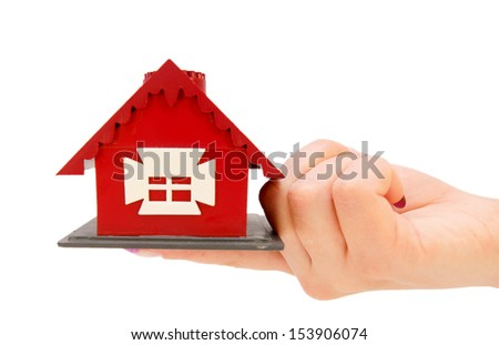 The toy house in hand. On a white background. - stock photo