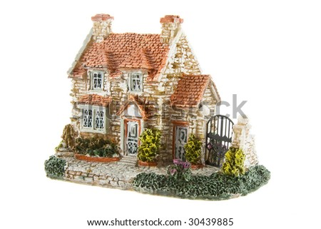 The toy house isolated over white background