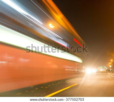 the trace of a moving bus at night