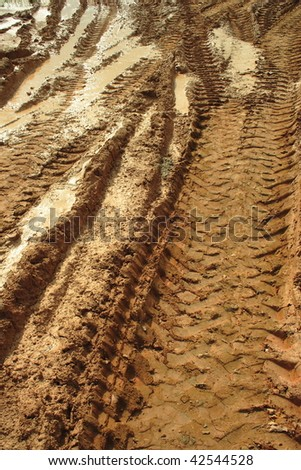 The trace of a tyre in the sand - stock photo