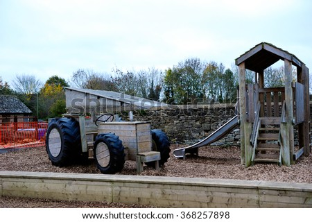 The tractor model which made of wood in a farm