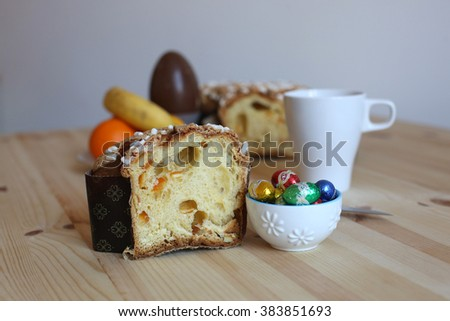The traditional Easter cake with candied fruit resting on a wooden table at breakfast