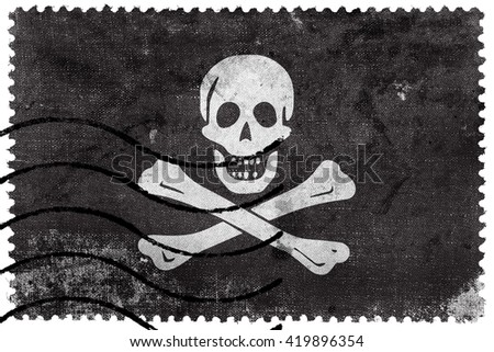 The traditional Jolly Roger of piracy Flag, old postage stamp