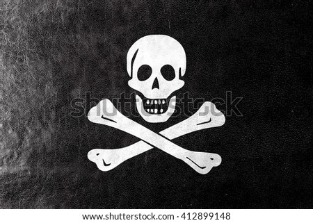 The traditional Jolly Roger of piracy Flag, painted on leather texture - stock photo