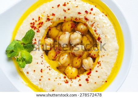The traditional Middle Eastern hummus with tahini,  - stock photo