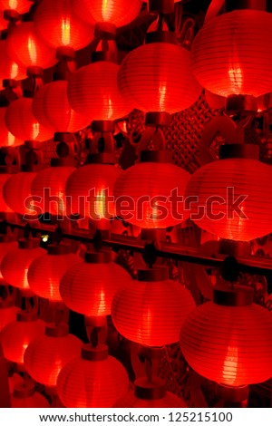 The traditional red lanterns at night for chinese new year - stock photo