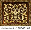 The Traditional Thai style art golden painting pattern on wood in temple. This is traditional and generic style in Thailand. No any trademark or restrict matter in this photo. - stock photo