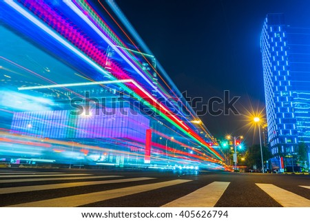 The traffic light trails in the street by modern building
