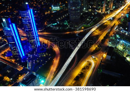 The traffic light trails in the street by modern building New York, Istanbul, London, Dubai, Frankfurt, Paris, Barcelona, Rome, Warsaw, Moscow or other big city - stock photo