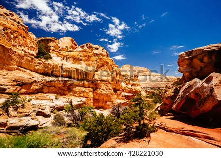 The trail to Hickman Bridge is Capitol Reef National Parks most popular hike and features fantastic views of the Waterpocket Fold and the majestic natural bridge. - stock photo