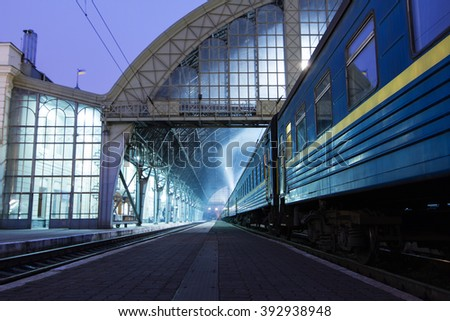 The train on the platform of railroad station in Lviv , Ukraine . - stock photo