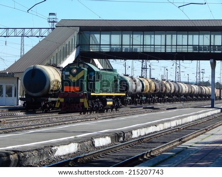 The train station. A freight train to transport oil in tanks.