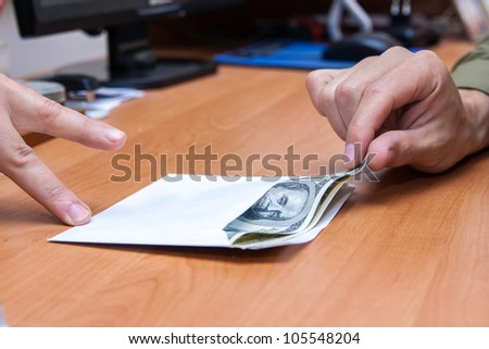 The transfer of an envelope with a bribe - stock photo