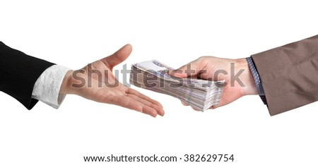 The transfer of money. Female and male hand with a bundle of banknotes. - stock photo