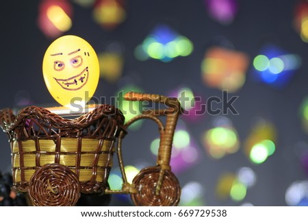 the transparency funny egg on rattan tricycle and many color bokeh