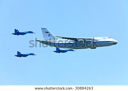The transport plane and fighters on air parade