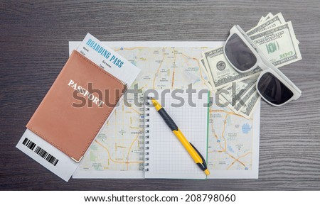 The travel concept. Passport, dollars, tickets, map and note - on wooden surface. Closeup. - stock photo
