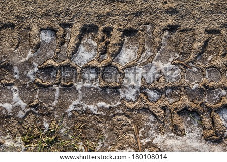 The tread pattern of the tire on frozen ground - stock photo