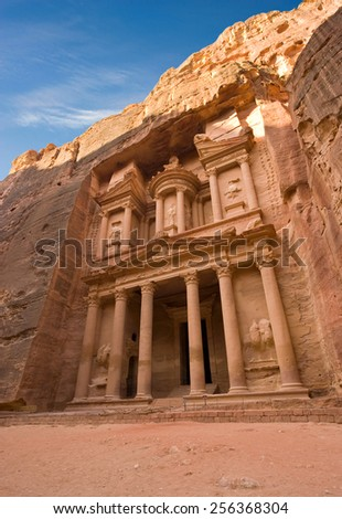 The treasury is also called Al Khazna, it is the most magnificant and famous facade in Petra Jordan, it is 40 meters high. - stock photo