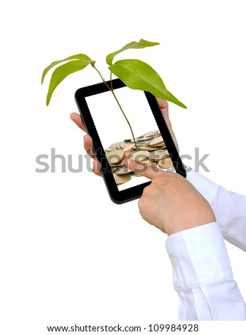 the tree and coin on touch pad PC - stock photo