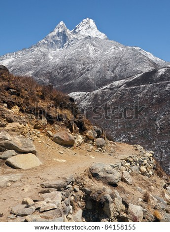 The trek near Ama Dablam (Everest region) - Nepal, Himalayas - stock photo