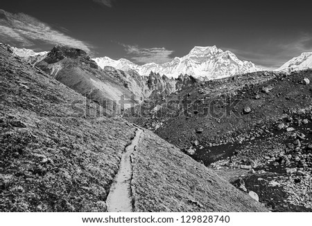 The trek to one of the highest peaks Gyachung Kang (7952 m) in the area of Cho Oyu - Gokyo region, Nepal (black and white) - stock photo