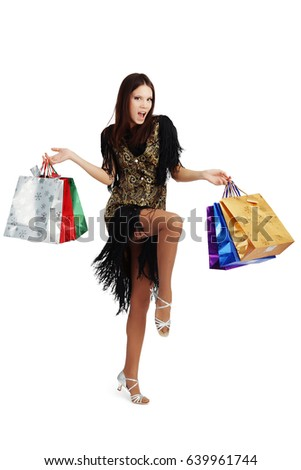 the trendy woman or rather girl smiling happy , colorful packaging or bags isolated on a white Studio background