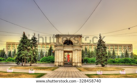 The Triumphal Arch and the Government building in Chisinau - Moldova - stock photo