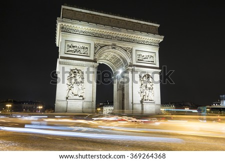 The Triumphal Arch  is the most famous monument in Paris.It stands in the center of the Place Charles de Gaule, at the western end of the Champs Elysees.It honours those who fought and died for France - stock photo