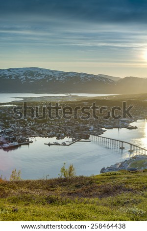 The Tromso Bridge (Tromsobrua), a cantilever road bridge in the city of Tromso that crosses the Tromsoysundet strait between Tromsdalen on the mainland and the island of Tromsoya, Norway. - stock photo