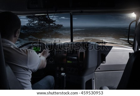 The truck driver on the night road. business trip