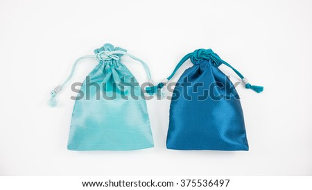The turquoise blue and deep blue silk mini gift pouch bags to hold jewelry.