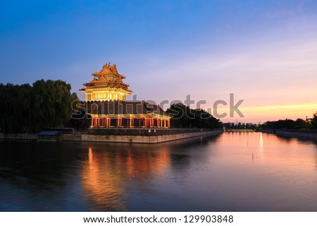 the turret of beijing forbidden city in sunset,China - stock photo