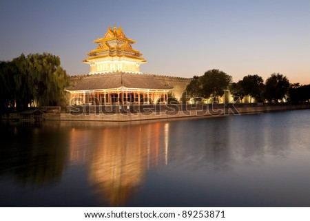 the turret of the forbidden city at dusk in beijing,China - stock photo