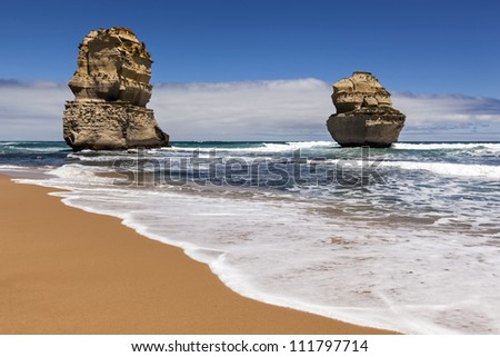 The Twelve Apostles, Victoria, Australia, near sunset. Two of the rock stacks, viewed from the beach.